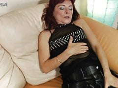 Redhead granny loves to simulate her hairy pussy