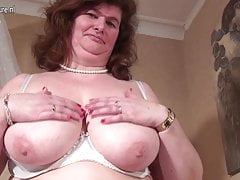 Obese Dutch mama playing about her hairy pussy