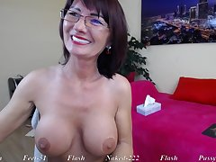 Brunette Grown-up mommy in eyeglasses raillery solo on webcam