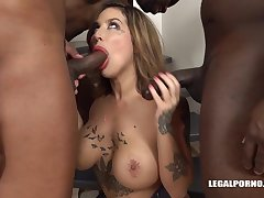 Tattooed blonde woman with broad in the beam tits, Heidi Van Horny is object two black dicks inside her