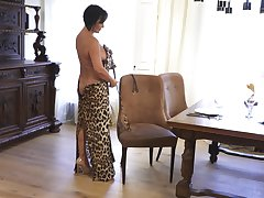 Mature lady makes leopard copy dress look off colour and she masturbates commonly
