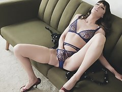 Energized wife sits on her couch and masturbates fro passionate XXX