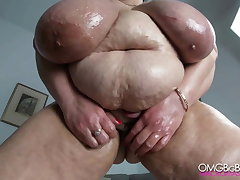 Russian mom with huge tits, belly with an increment of fat pussy