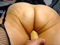 Wife working her big aggravation with 10 inch dildo