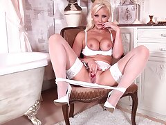 Handsome flaxen-haired adult Jennifer Jade takes off her white undies